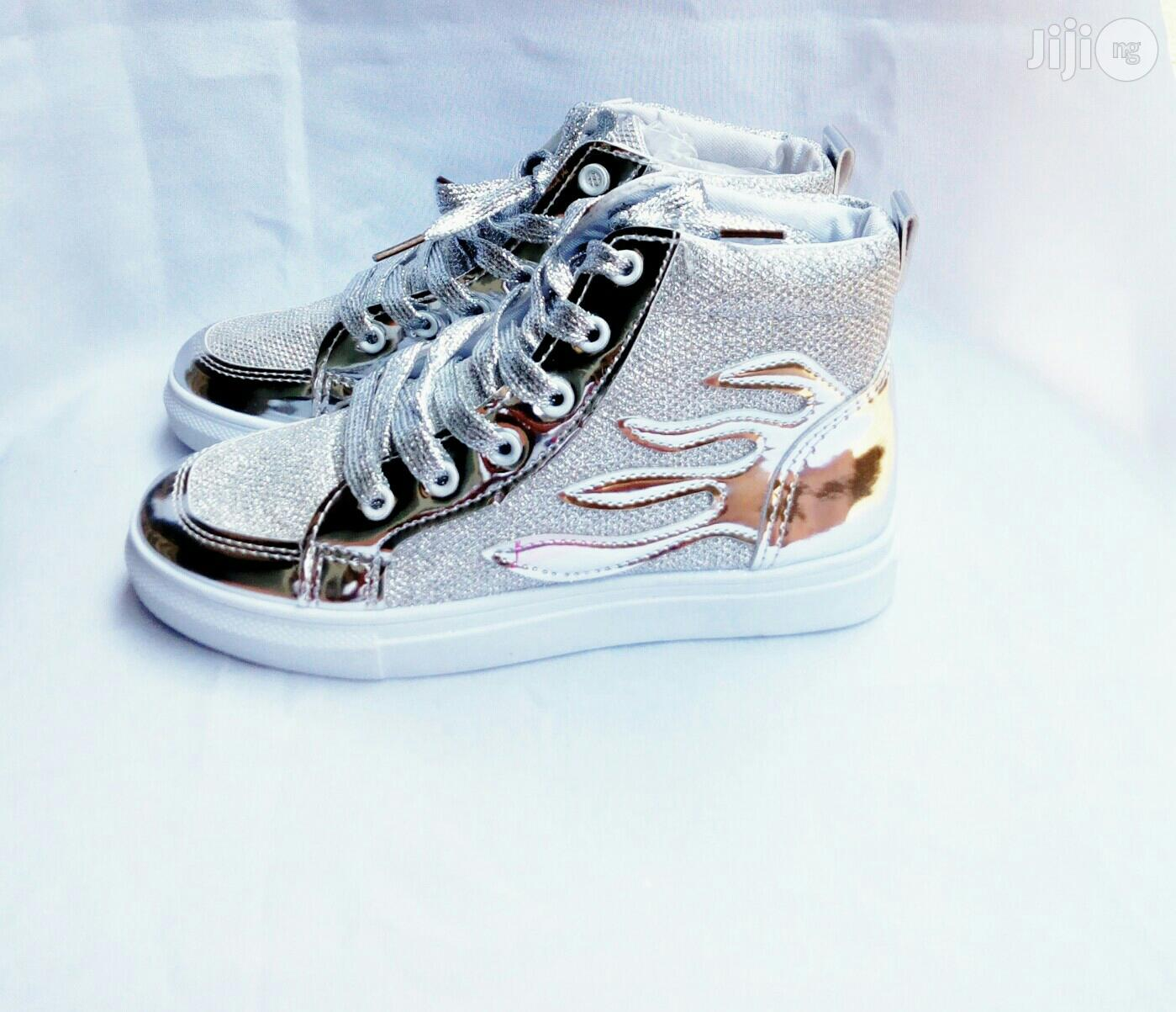 Silver Colored Laced Up High Top