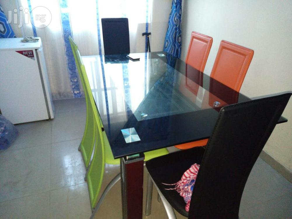 Padded Glass Dining Table With Six Chairs