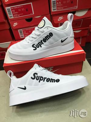 Nike Supreme White Lace Up Sneakers in
