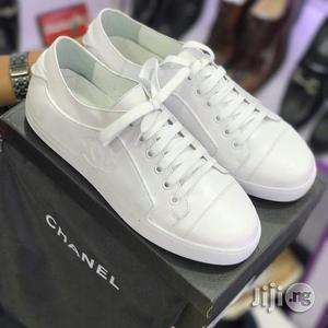 Chanel Triple White Low Top Sneakers in