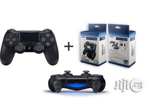 Sony Ps4 Controller Pad - Black + Dual Wireless Charger | Accessories & Supplies for Electronics for sale in Lagos State, Ikeja