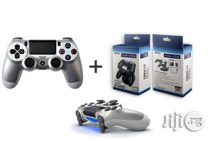 Sony PS4 Controller Silver +Daul Charger | Accessories & Supplies for Electronics for sale in Lagos State, Ikeja