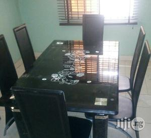 Trendy Padded Glass Dining Table