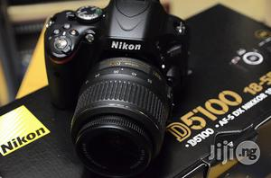 Nikon D5100 Camera With Charger and Original Battery | Photo & Video Cameras for sale in Lagos State, Ikeja
