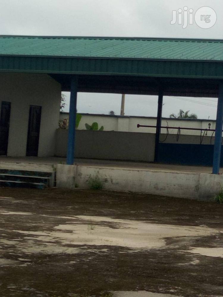 2 Acres With Mega Filling Station At Sapele Area Wori/Benin Road.