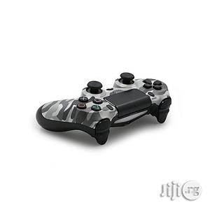 Play Station 4 Dualshock Wireless Controller Pad- Urban Camo | Accessories & Supplies for Electronics for sale in Lagos State, Ikeja