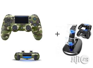 Sony PS4 Dualshock Wireless Controller - Camo + Free Two Pads Charger | Accessories & Supplies for Electronics for sale in Lagos State, Ikeja