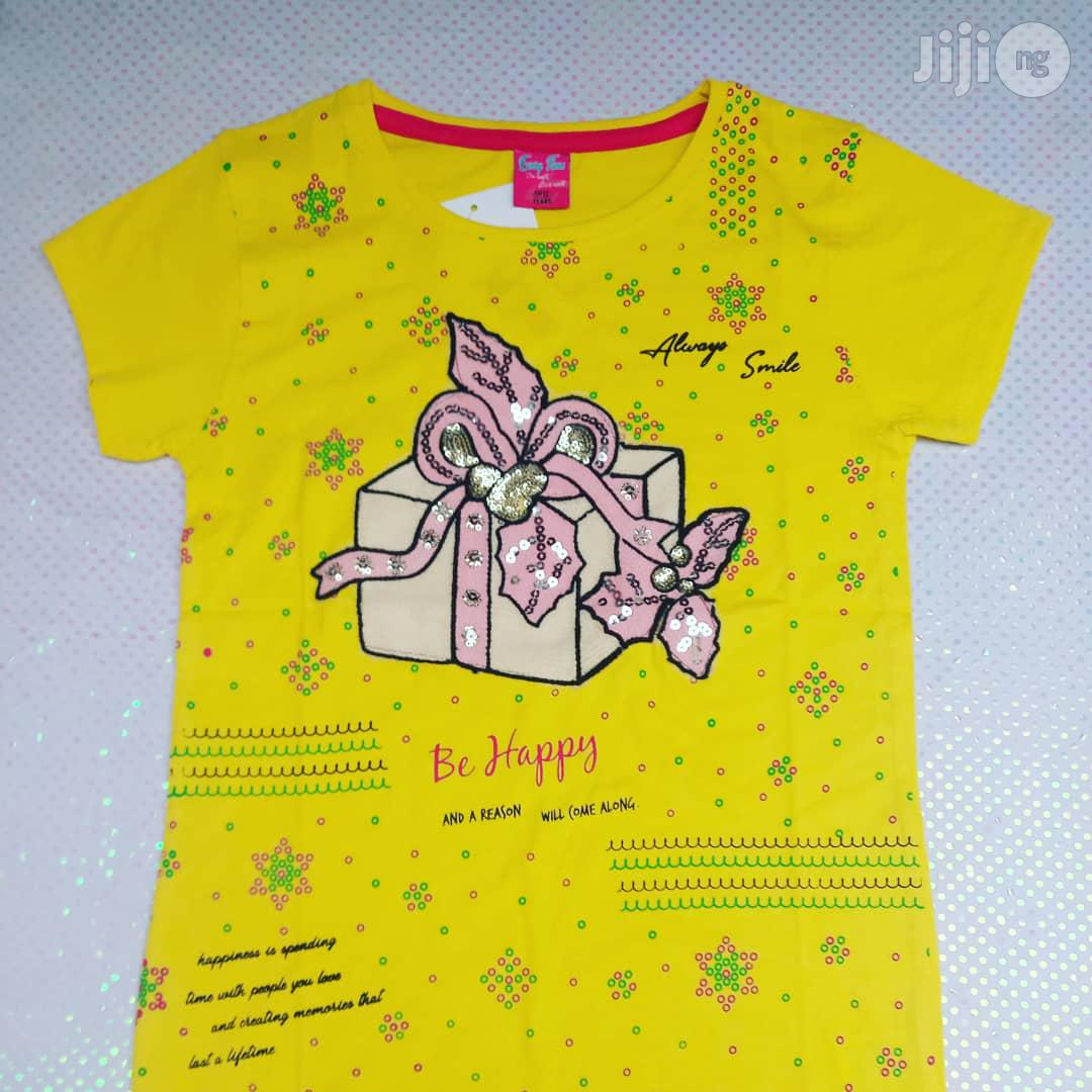 Girls Top in Yellow Background