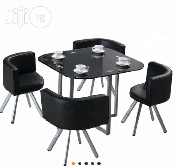 Archive: A Super Smart High Quality Glass Dinning Table With Four Chair's