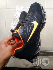 Nike Black Canvas With Orange Strides For Men | Shoes for sale in Rivers State, Port-Harcourt