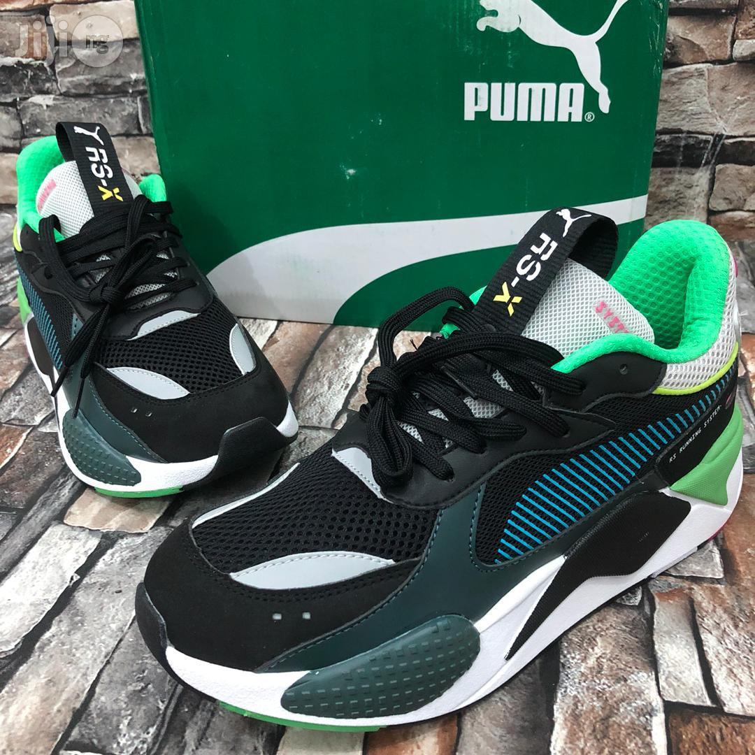 Original PUMA Rs-x Toys Black/Blue Atoll• in Surulere - Shoes, Kunleski  Clothing Luxuries   Jiji.ng for sale in Surulere   Buy Shoes from Kunleski  Clothing Luxuries on Jiji.ng
