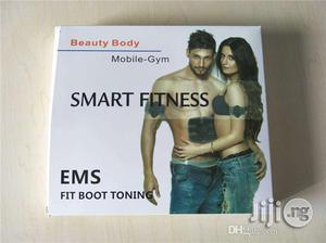 EMS Muscle Stimulator Smart Fitness Mobile -gym Abs Trainer For The Slimming Body High Quality Muscle Toner Abdominal Belt   Tools & Accessories for sale in Lagos State, Surulere