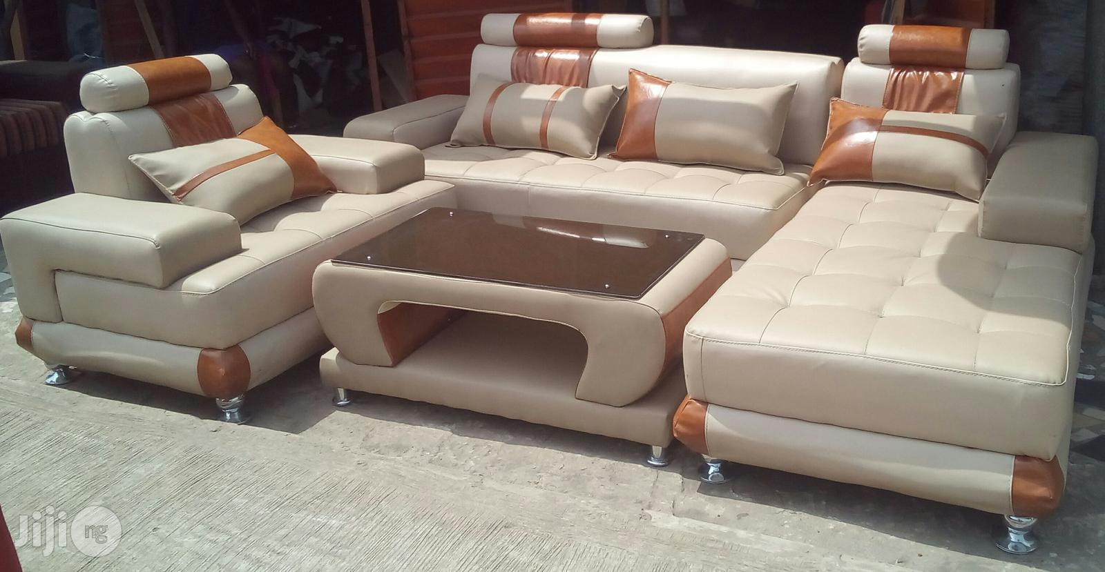 Set Of Living Room Couches And A Centre Table. L-shaped Couches With A Single Seater Chair