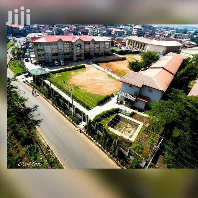 Strategically Located School Structures on Two Acres Near UI for Sale