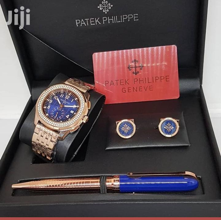 Patek Philippe Rose Gold Chain Watch And Pen And Cufflinks