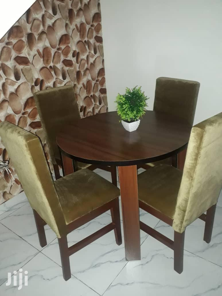 Archive: Four Seater Dining Set With a Round Table