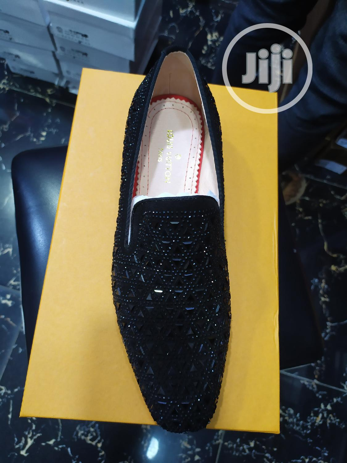 Gucci, Christian Louboutin, Versace Louis Vuitton Brand Collections