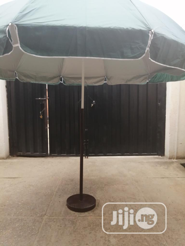 Modern Stand With Branded Parasol Umbrella