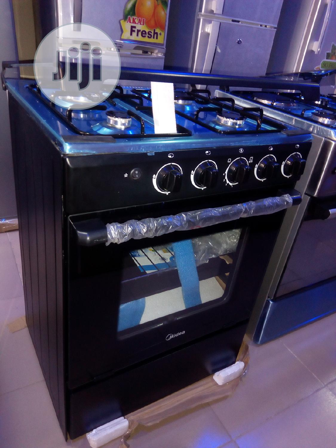 Midea 4 Burner Gas Cooker With Oven - Auto Ignition