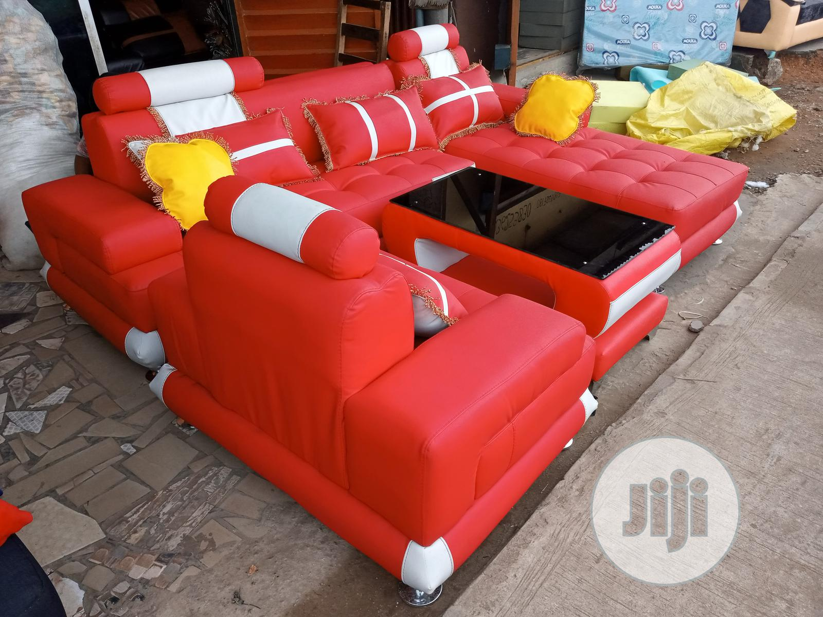 Archive: Set of L-Shape Sofa With Single Seater Chair and Table