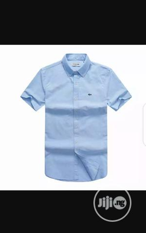 Lacoste Plain Short Sleeve Shirt Sky Blue Original 023 | Clothing for sale in Lagos State, Surulere
