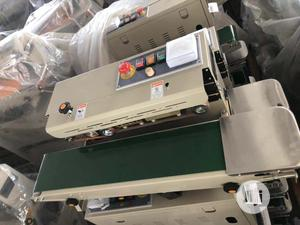 Auto Sealing Machine For Nylon Chin Chin Milk Tea Soap Chips Popcorn   Manufacturing Equipment for sale in Lagos State, Amuwo-Odofin