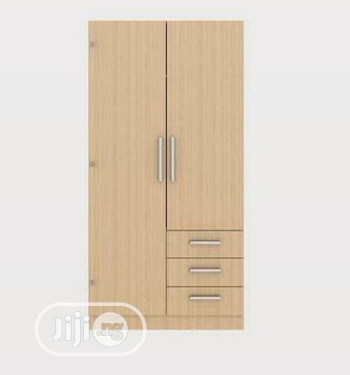 A Brand New Akala Two Doors With Thee Drawers Standard Wardrobe. | Furniture for sale in Lagos State, Nigeria