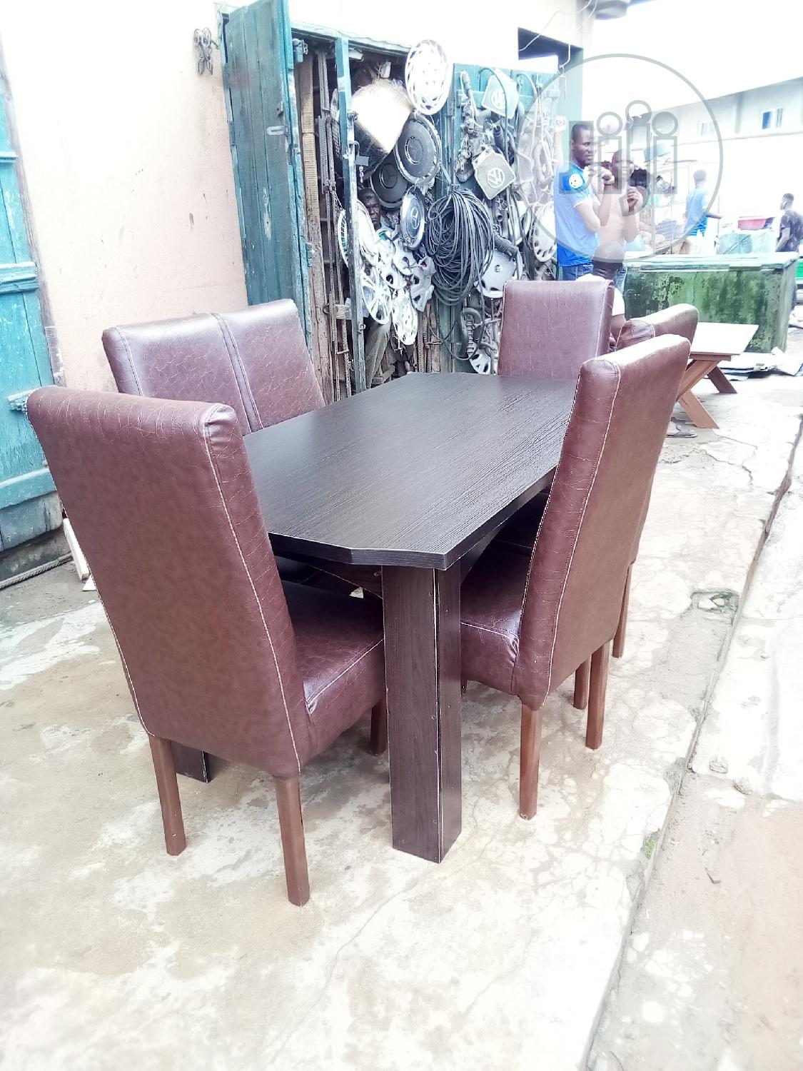 Dinning Chair Six With Middle Glass Table | Furniture for sale in Oshodi, Lagos State, Nigeria