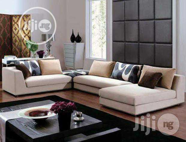 Luxurious L- Shaped Sofa with Throw Pillows
