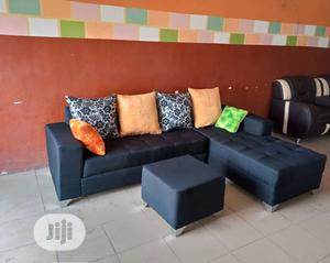 An L-Shape Seater Chair With Throw Pillows and Ottoman   Furniture for sale in Lagos State