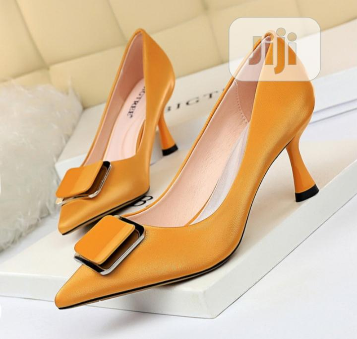 Archive: High Heeled Shoe With Pointed Metal Belt Buckle