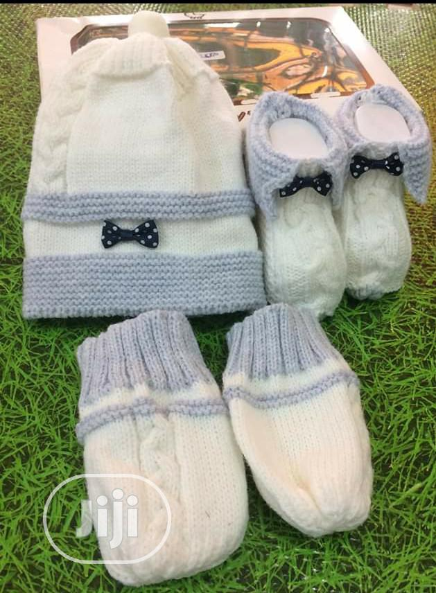 Set Of Knitted Cap, Baby Booties And Baby Mittens