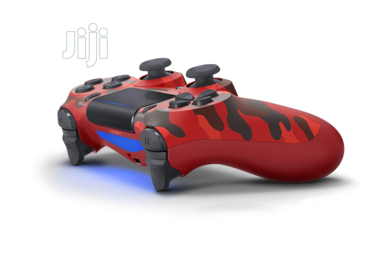 Sony Dualshock 4 Wireless Controller For Playstation 4 - Red Camo | Accessories & Supplies for Electronics for sale in Ikeja, Lagos State, Nigeria