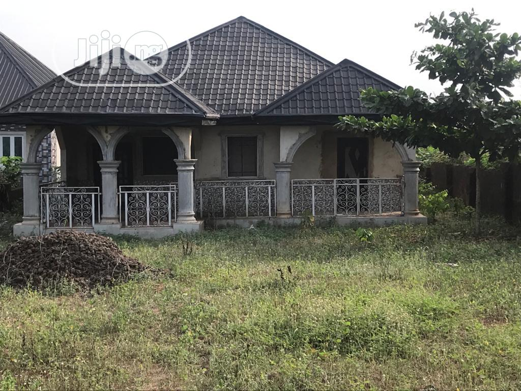 65 By 130 Land With 4bedroom Bungalow At Igbuzo, Delta