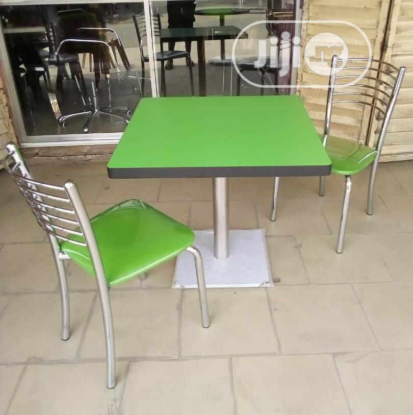 Classic Set of Imported Wooden Top Table With Pure Stainless Chairs