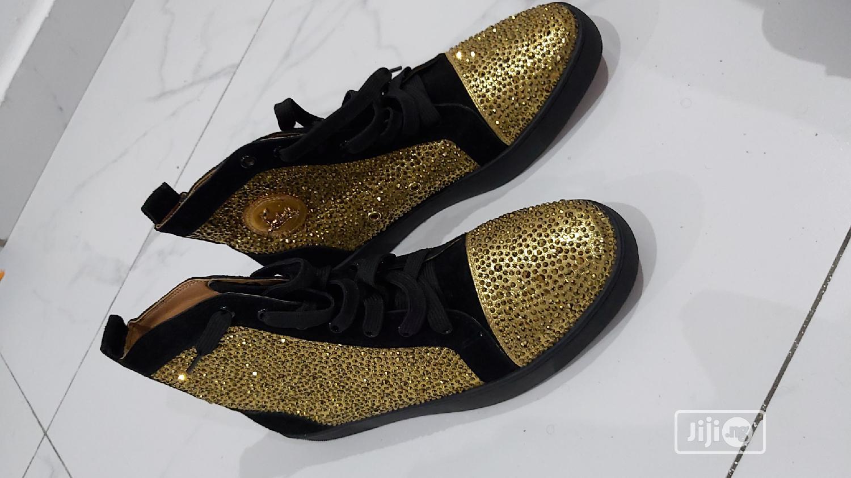 louboutin gold black