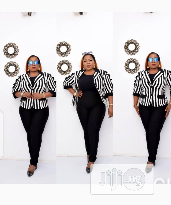 New Quality Female Turkey Strip Jacket and Black Jumpsuit | Clothing for sale in Victoria Island, Lagos State, Nigeria