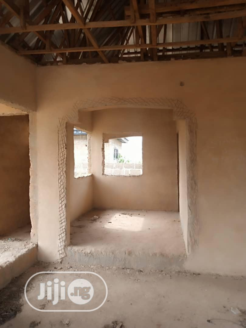 Very Cheap Already Roofed Uncompleted 2flats On 50x100ft For Sale