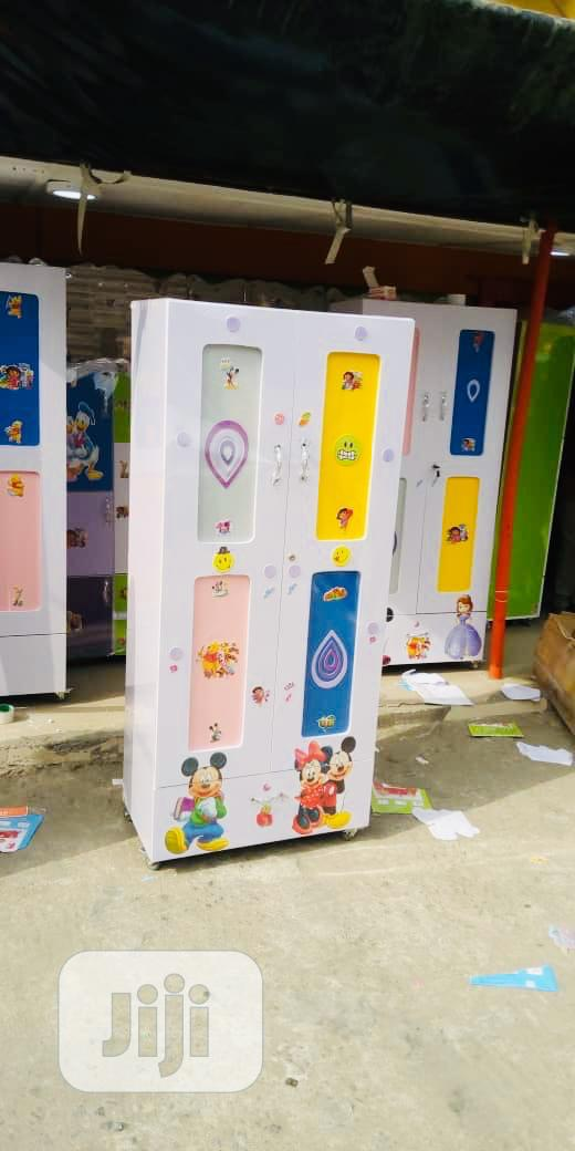 Archive: Kids Beautiful Wooden Wardrobe With Different Compartments