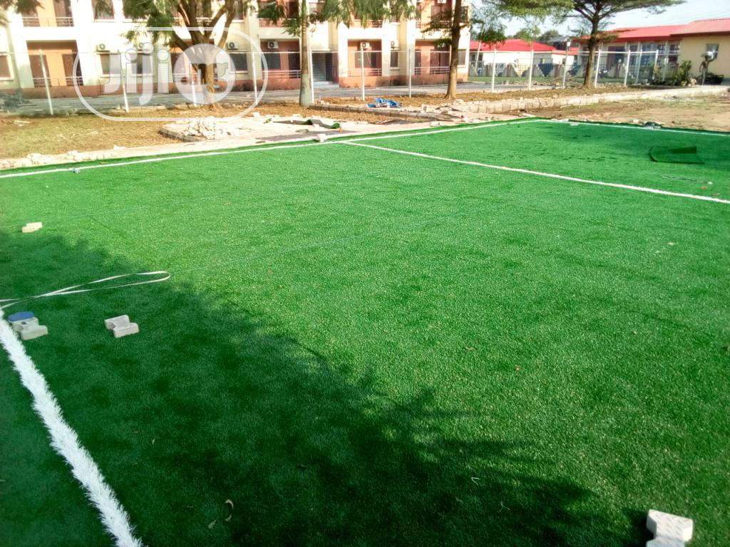 Synthetic Carpet Grass Installation For Mini School Field