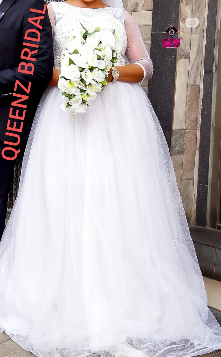 Beautiful Foreign Lace Studded Ball Wedding Gown For Rent | Wedding Wear & Accessories for sale in Alimosho, Lagos State, Nigeria