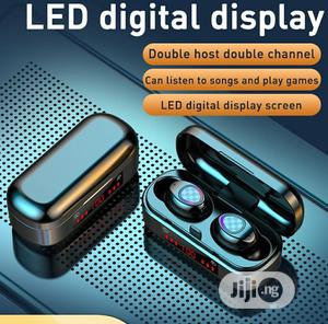 Waterproof Portable Earbuds LED Double Digital Display Noisecancelling   Headphones for sale in Lagos State, Ikeja