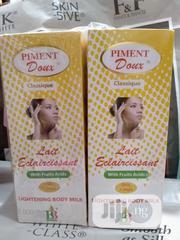Pigment Doux Lait Eclaircissant Body Milk 250ml | Skin Care for sale in Lagos State, Amuwo-Odofin