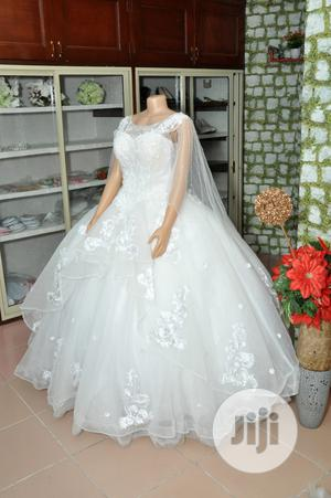 Wedding Gown for Rent With Veil, Basket,Tiara,Bouquet, Robe   Wedding Wear & Accessories for sale in Lagos State, Magodo