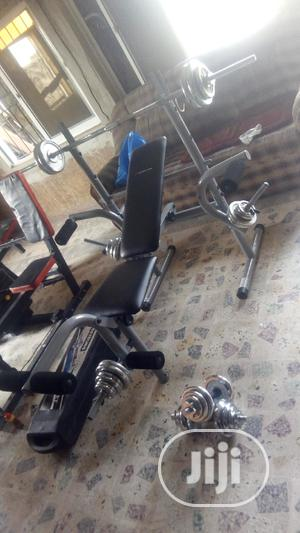 Weight Lifting Bench And 50kg Weight With Barbell   Sports Equipment for sale in Lagos State, Ikeja