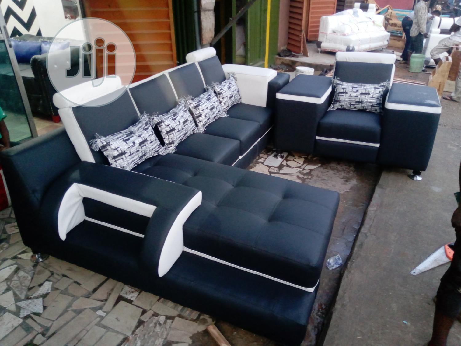 Archive: L- Shaped Leather Sofa With Throw Pillows