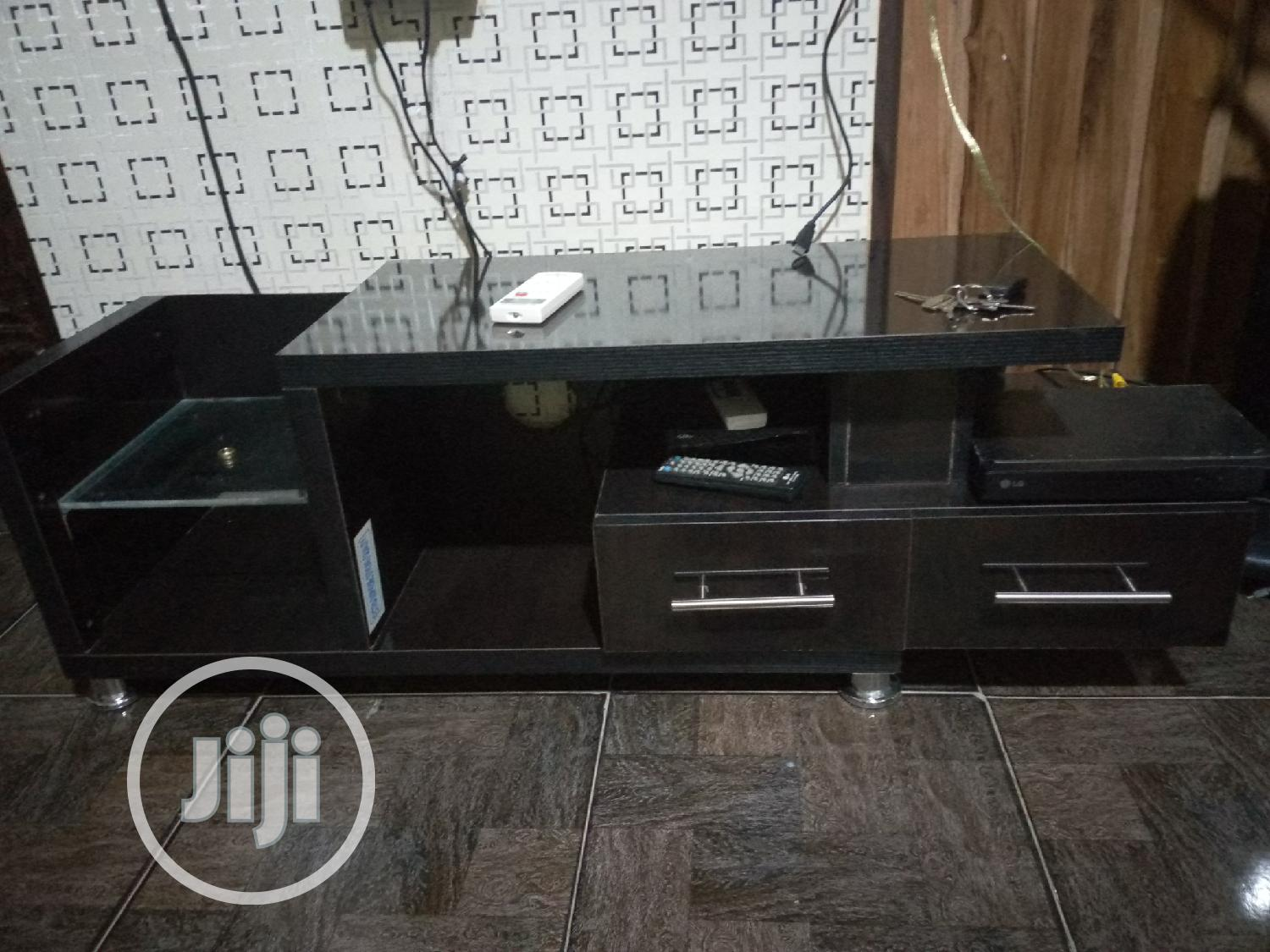A New Television Shelf With 2 Drawers.Made Wt Good Material
