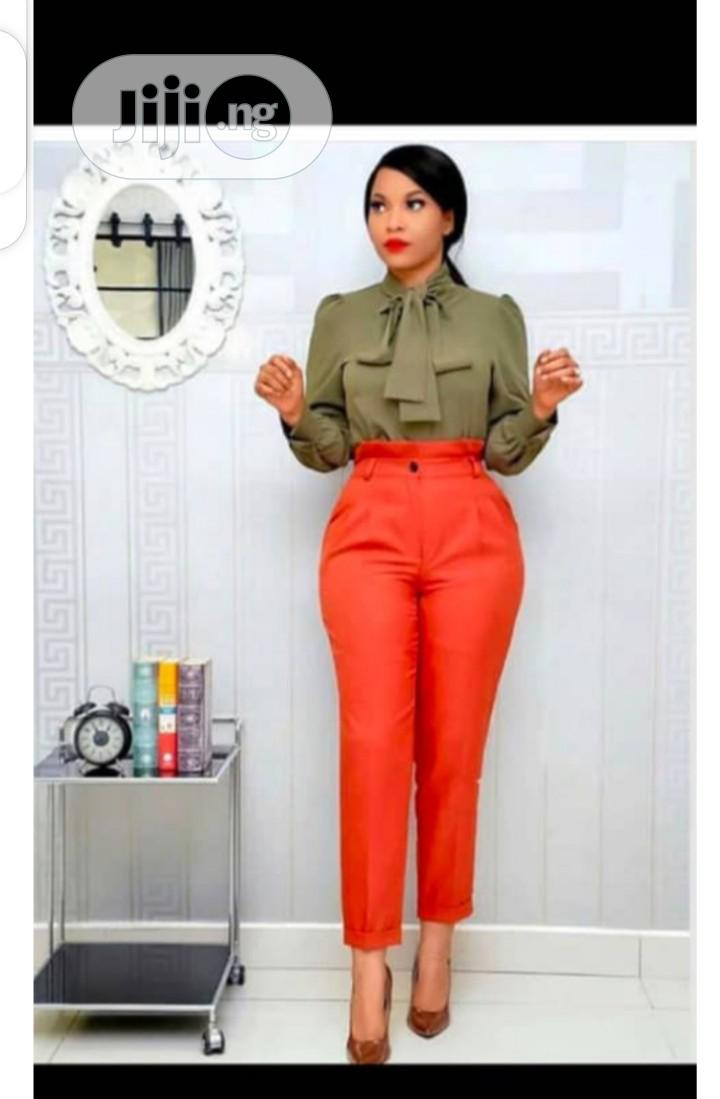 Female Trousers and Turtle Neck Top