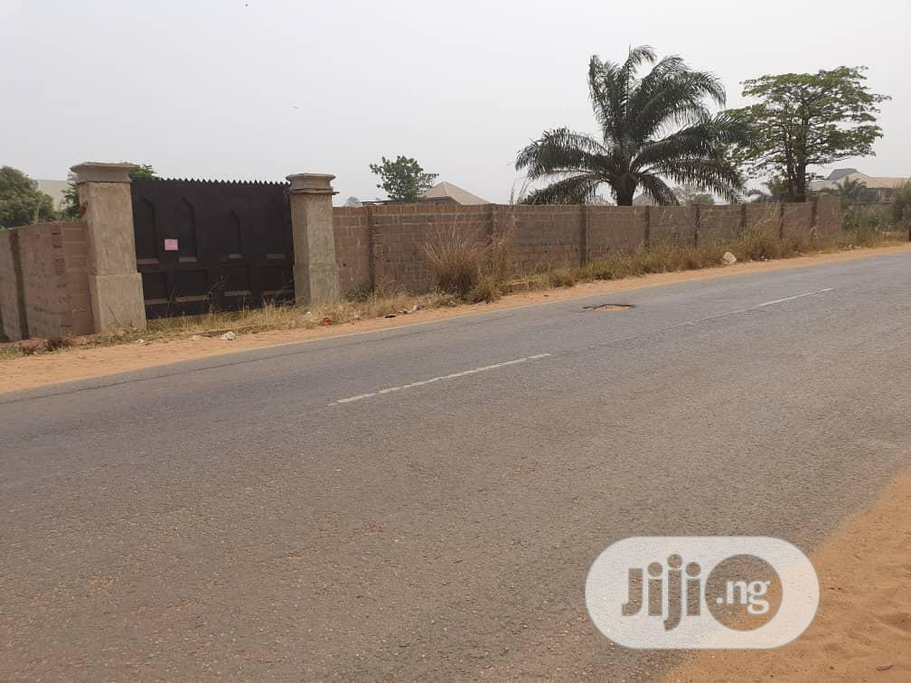 Archive: Two Plots Of Land Fenced With Gate On The Main Road In Isu For Rent