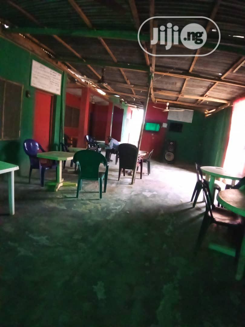 Functioning 13 Rooms Hotel on a Full Plot of Land at Ikola Command